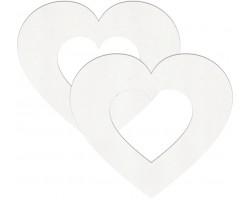 Белые пестисы на грудь в форме полых сердечек