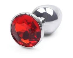 Серебристая анальная пробка с красным кристаллом - 7 см.
