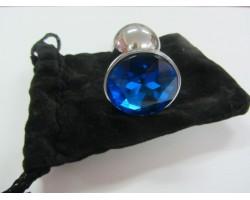 Серебристая анальная пробка среднего размера с синим кристаллом - 8 см.