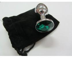 Серебристая анальная пробка среднего размера с изумрудным кристаллом - 8 см.