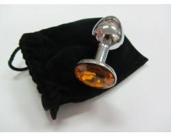 Серебристая анальная пробка среднего размера с оранжевым кристаллом - 8 см.