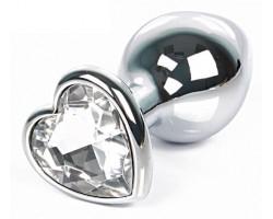 Серебристая анальная пробка с прозрачным кристаллом-сердцем размера L - 9,5 см.