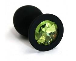 Чёрная силиконовая анальная пробка с светло-зеленым кристаллом - 7 см.