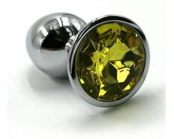 Серебристая алюминиевая анальная пробка с желтым кристаллом - 7 см.