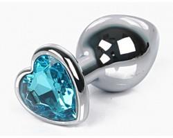 Серебристая анальная пробка с голубым кристаллом-сердцем размера L - 9,5 см.